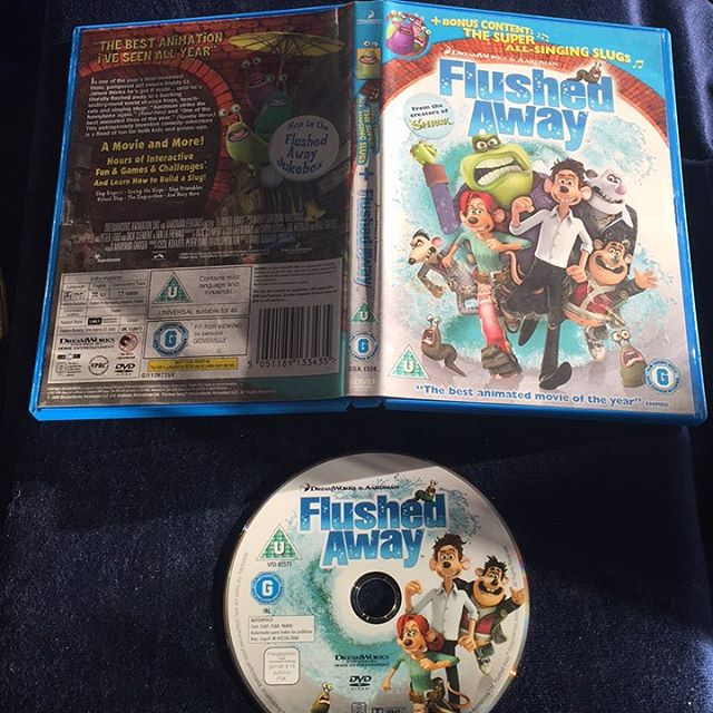 Flushed Away, contains disc and box, used and disc has scratches in the  centare on the back
